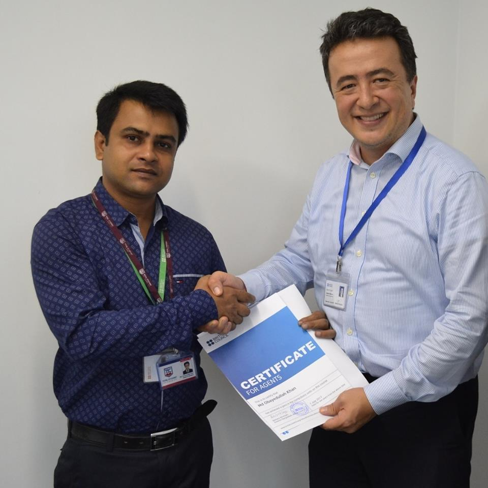 British Council Dhaka, handing over Agent Training Certificate to Director of Operation, Bangladesh